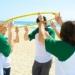 Frisbee gooien bij Bedrijfsuitje Strand
